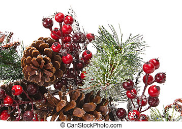 Pine branch with berries, ornaments, cones and snow