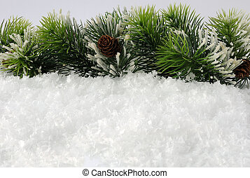 Pine branches with a lump in the snow