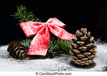 pine cone with bow out of focus and