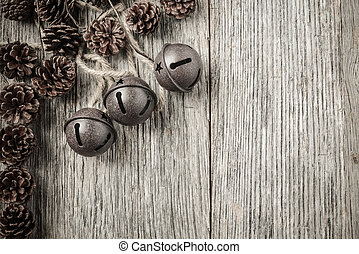 Pine cones and Rustic Bells on an Old Wood Background