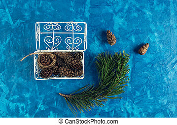 pine cones in a beautiful vintage chest