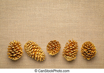 pine cones on burlap canvas