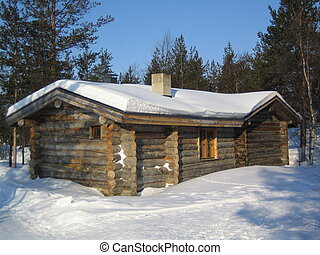 pine logs cottage in lapland, finland