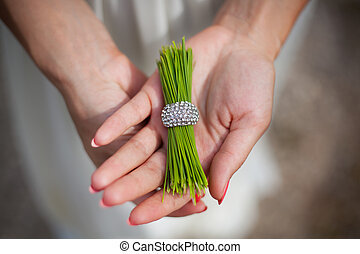 pine needles with a ring in the hands of girl