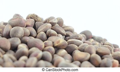 Pine nuts in bulk - Weight of pine nuts in bulk on a white...