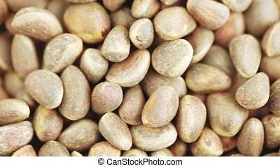 Pine nuts in bulks - Weight of pine nuts in bulk on a white...
