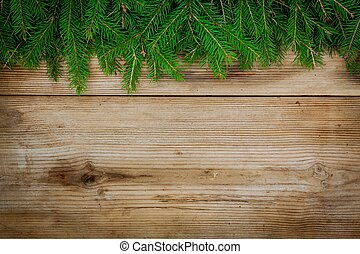 Pine tree border on old wooden background