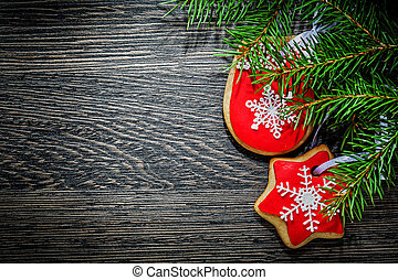 Pine tree branch Christmas cookie on wooden board