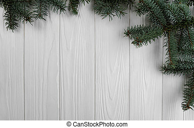 Pine tree branches on wooden background
