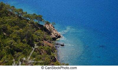 Pine tree with blue sea laguna background Turkey - Summer...