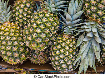 Pineapple (Ananases) at market. - Pineapples (Ananases) at...