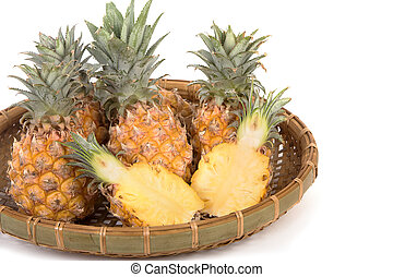Pineapple and slices isolated on white background