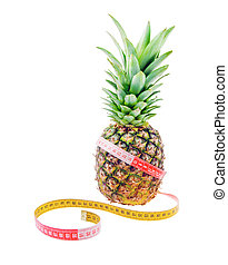 Pineapple and tape measure as reducing weight concept