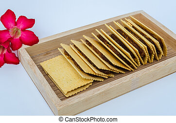 Pineapple bread, on a tray made of wood, white background.