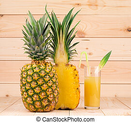 pineapple fruit and pulp on wooden background
