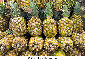 Group of pineapple at public market in Barcelona, Spain.