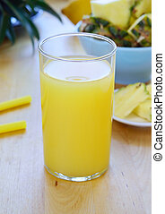 Pineapple juice in a glass on table