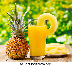 pineapple juice - glass of pineapple juice with fresh fruits