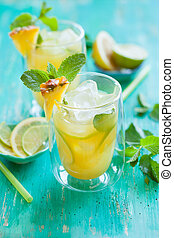 Pineapple lemonade with lemon, lime and mint