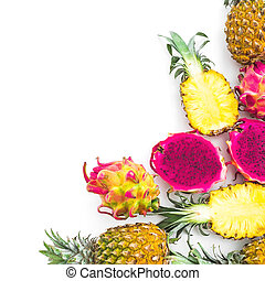 Pineapple, mango and dragon fruits isolated on white background. Flat lay, top view. Tropical concept.