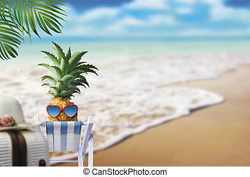Pineapple on chair at the beach with copy space summer concept