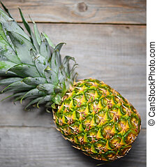 Pineapple on wooden table close up
