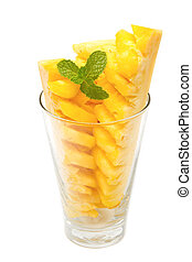 Pineapple slices in glass with mint leaf on white background