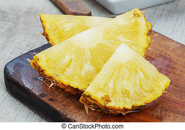 pineapple slices on wooden.