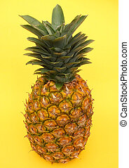pineapple on yellow background