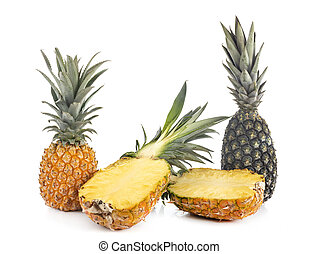 delicious pineapples in front of white background