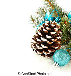 Pinecone with christmas decoration and blue ball over white