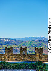 Pinion city wall of San Marino, mountains in the background ...