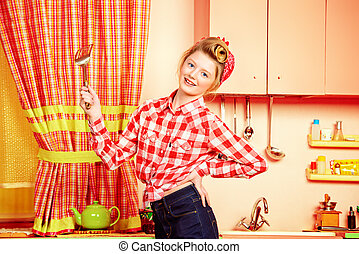 pink addicted - Pretty pin-up girl teenager cooking on a...