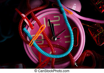 Pink alarm clock with colorful knick-knacks