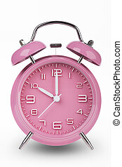Pink alarm clock with the hands at 10 am or pm isolated on a white background.