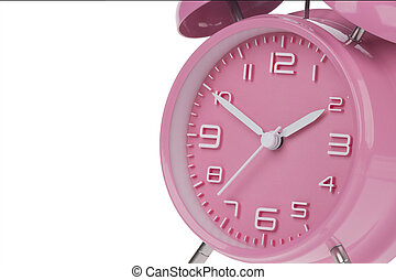 Pink alarm clock with the hands at 10 and 2 am or pm ...