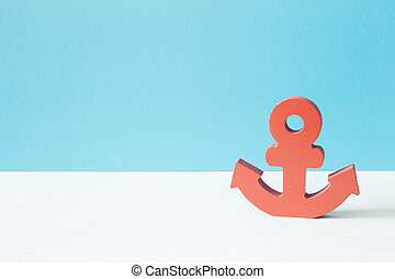 Pink anchor on blue background, summer marine decoration