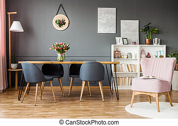 Pink and grey dining room - Pink armchair next to grey...