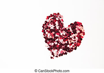 Pink and red confetti in heart shape