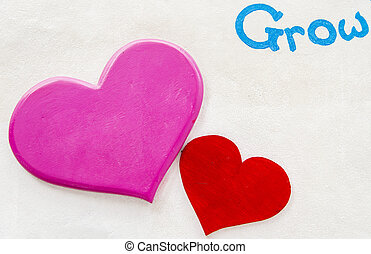 Pink and red heart on white wall