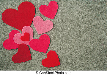 pink and red hearts on gray felt background. valentine's day