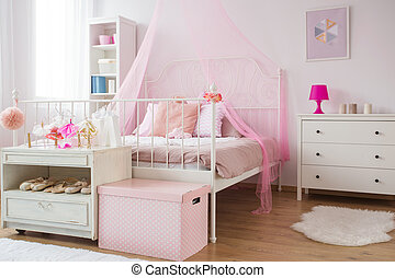 Pink and white princess bedroom with bed and dresser