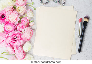 Pink and white ranunculus flowers with lipstick, makeup ...