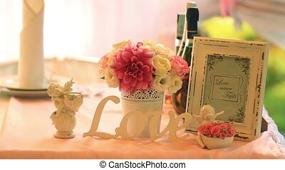Pink and white roses bouquet with photoframe over wooden table