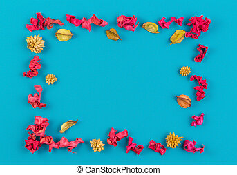 Pink and yellow dried flower plants rectangular border frame on blue background. Top view, flat lay.