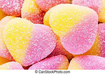 Top view sugar coated assorted candy making background