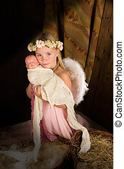Pink angel in nativity scene