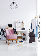 Pink armchair in dressing room