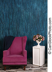 pink armchair on the background of the emerald wall. Vase with Flowers, interior design