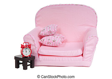Pink artchair with table and alarm clock isolated on white background